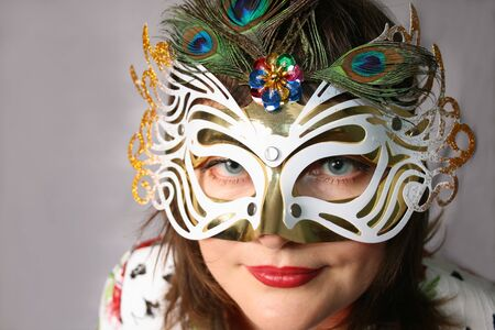 Portrait of attractive beautiful young woman wearing carnival mask photo