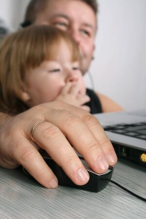attentive: Thoughtful father and attentive daughter using Laptop Stock Photo