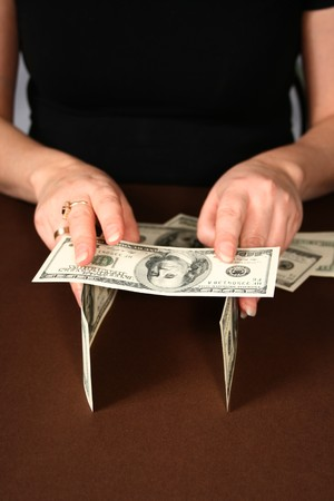 The unsteady house money in human hands photo