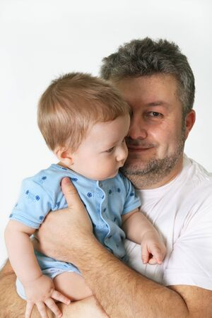 assume: Father hold his son on his ones arms and smiling Stock Photo