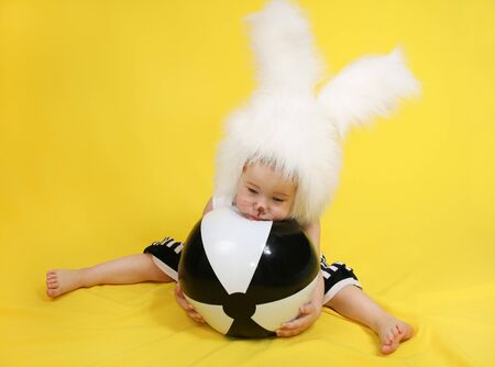 downy: little girl in a white downy bunny costume.