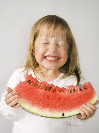 Picture of young girl and a slice of watermelon