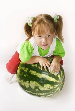 kindred: Small girl sits on top of the large watermelon