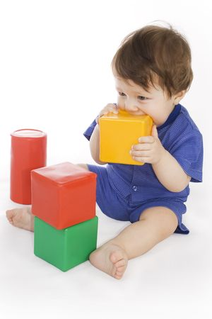 Small child plays with the colored toys