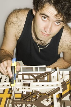 A young architect working on a model of a new construction. photo