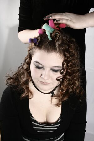 Young woman having her hair curled by hairdresser Stock Photo - 5469311