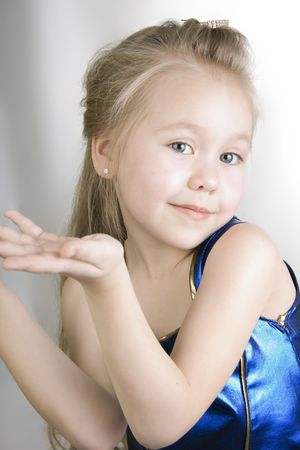 curtsy: Little girl dressed as a pretty blue princess curtsy. Stock Photo