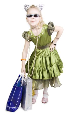 Fashionable little girl and her Shopping. photo