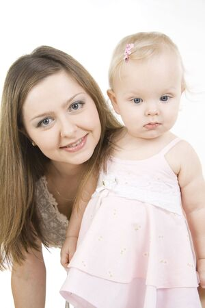 Young and beautiful mother with her sweet little daughter isolated on white. Stock Photo - 6782277