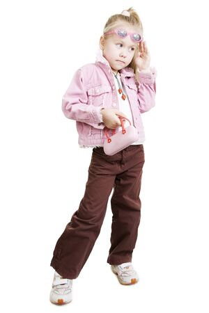 The fashionable little girl wearing sun glasses photo