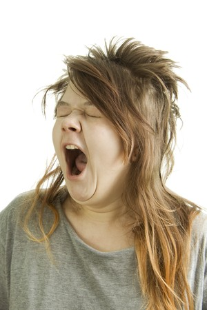 absurd: Sleepy and shaggy girl yawning. Stock Photo