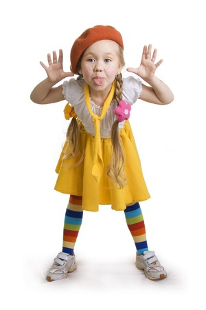 impish: little girl grimacing. Stock Photo