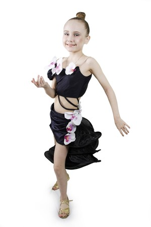 Little girl dancing to a white background Stock Photo - 7967882