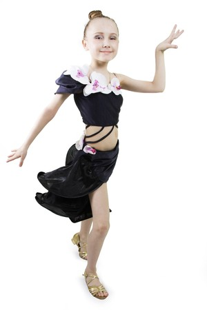 Little girl dancing to a white background photo