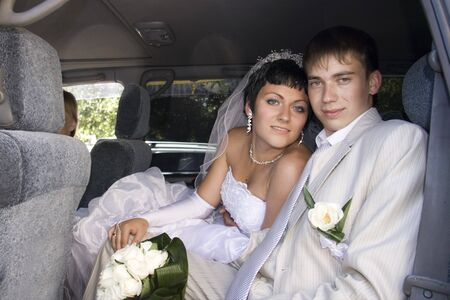 Bride and Groom in car photo