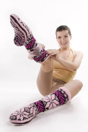 Beautiful knitted socks at the girl. photo