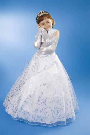 reverent: White girl Princess. Sleeping Beauty. Blue background.