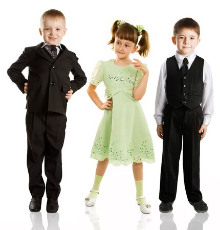3 fashionable children stand on a white background photo