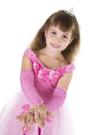 The girl the princess in a pink dress sits opposite to a white background photo