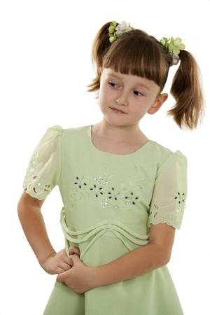 reverent: The little girl looks aside. A background white.