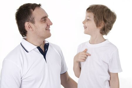 Father and son cheerfully talk. On a white background. photo