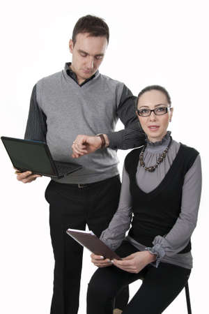 Businessman and businesswoman discuss working hours moments photo