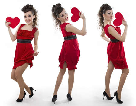 Beautiful Asian women in a red dress shows the heart form - a love symbol photo