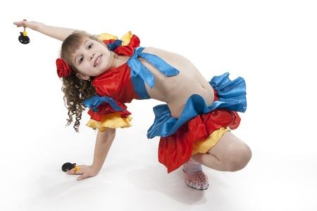 spaniard: Portrait of the little girl dancer to a white background Stock Photo