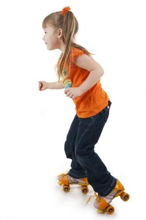The little girl on roller skates.  Isolated white photo