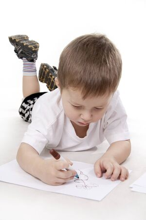 writing activity: Cute little boy drawing