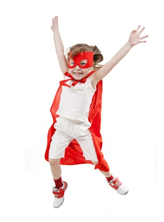 Superhero little girl in a red raincoat and a mask
