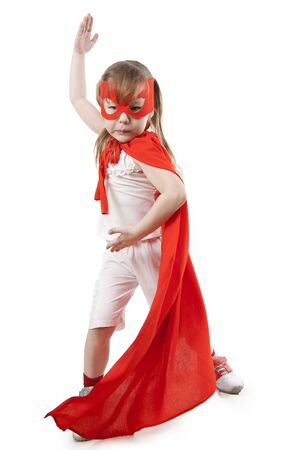 boldness: Superhero little girl in a red raincoat and a mask