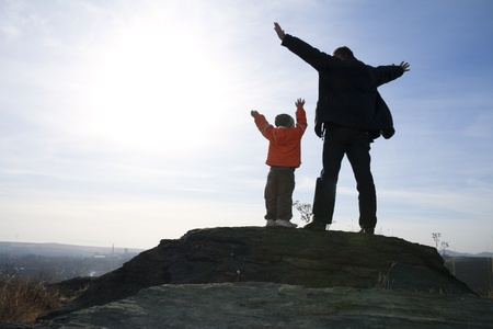 Expressing Father and Son stand on the stone,  Arms Raised to heaven.