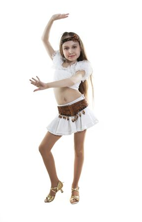 little girl smiling: Portrait of the young dancer girl to a white background Stock Photo