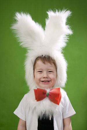 Boy in a white downy bunny costume. photo