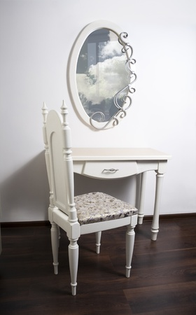 modernist: White Table, chair, mirror in ancient, modernist style Stock Photo