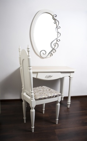 baroque room: White Table, chair, mirror in ancient, modernist style Stock Photo
