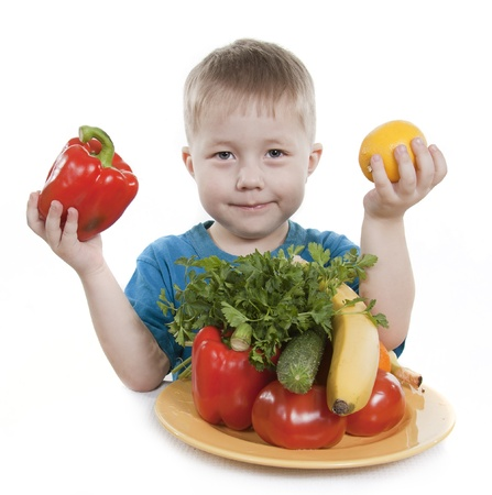 Vegetables and fruit it are a healthy food of children. Child holds different vegetables and fruit. Stock Photo - 9226598