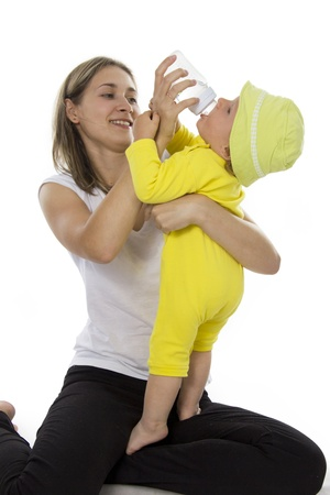 Mother gives to drink water of the child from a small bottle Stock Photo - 14403377