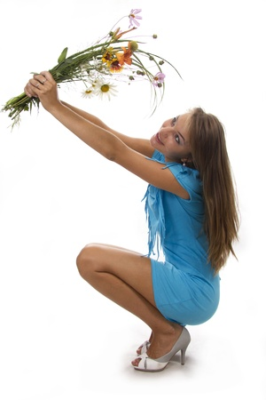 Beautiful girl holds a bunch of flowers, isolated Stock Photo - 12118279