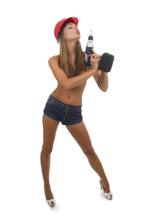 power tools: Beautiful girl holds a drill in a hand. Isolated background. Stock Photo