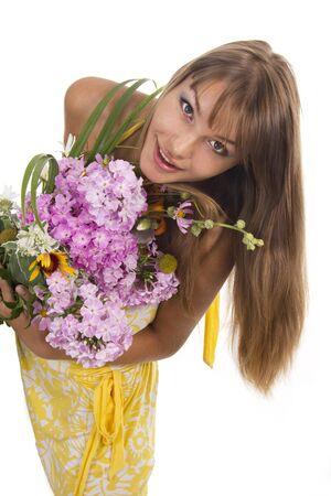 Beautiful girl holds a bunch of flowers, isolated photo