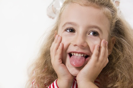 Cheerful little girl smile. White isolated. photo