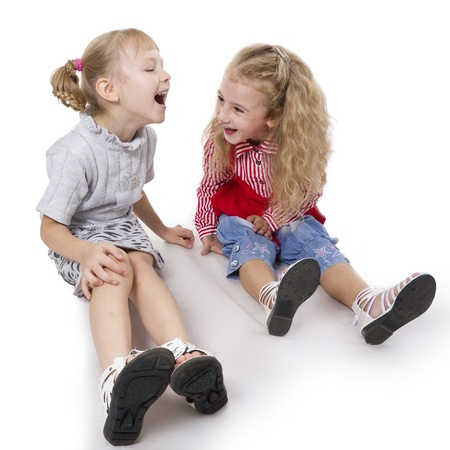 elementary age girl: Two fun girls of the girlfriend play. White isolated.