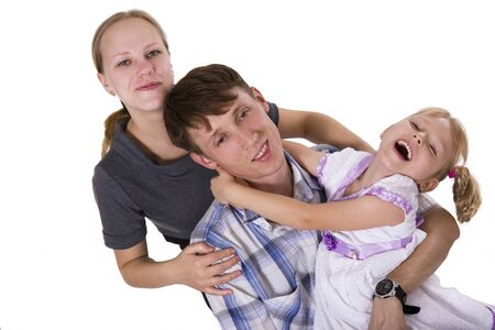 Young European family from three persons - mother, father and daughter. Isolated photo