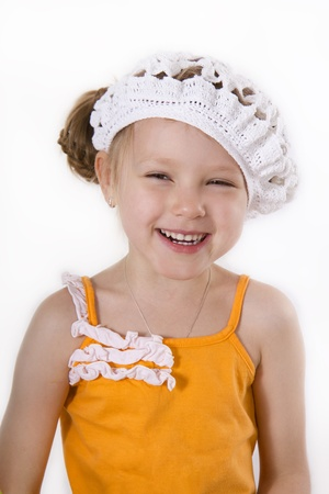 playful behaviour: Cheerful little girl smile. White isolated.