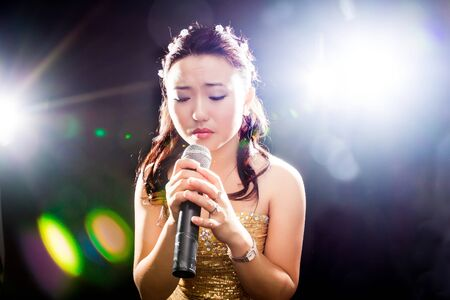 Concert young Asian singer of the girl photo