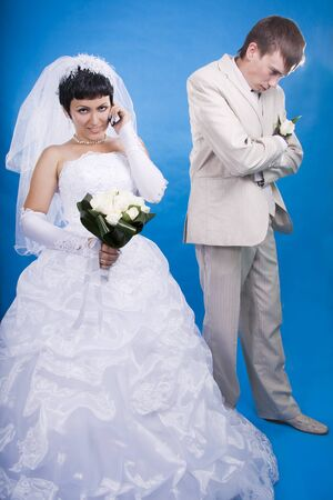 The groom and the bride in a conflict situation photo