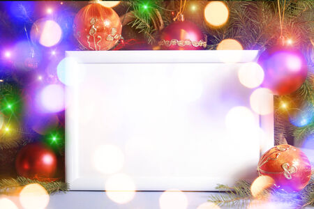 Colorful abstract background with christmas lights and white frame.   Christmas background with Ribbon boll and ornaments photo
