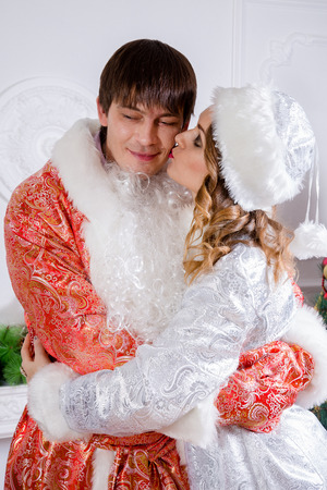 period costume: Cheerful family celebrating Christmas. Russian traditions. Father Frost and maiden Snow.